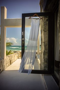"A Low-Key Tulum Wedding That's Beach Perfection #refinery29  http://www.refinery29.com/tulum-wedding#slide-9  Can you talk a little bit more about the vibe and some of the special touches you created?  ""I collaborated with my good friend and extremely talented fashion designer Valentina Kova to design my wedding dress. After the ceremony, I proclaimed that it was 'time to party,' and she took out a big pair of scissors and cut the long, sheer train into the shorter dress so I could dance. It ..."