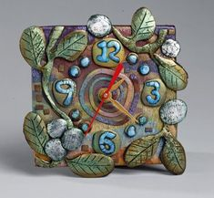 """I've listed a few new polymer clay items in my aMused Etsy Shop . I'm offering a Polymer Clay wall mount """"Snowberry Clock"""" and one of my lat. Clay Projects, Clay Crafts, Garden Projects, Polymer Clay Kunst, Clay Vase, Clock Art, Pottery Techniques, Polymer Clay Flowers, Notebook Covers"""