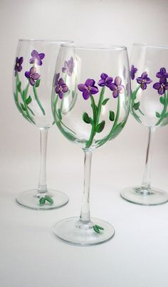 Purple violets - hand painted wine glasses - set of 4 Made to Order. $54.00, via Etsy.