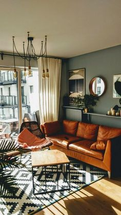 25 Elegant Living Room Wall Colour Ideas Matching with Furniture Top designers share their favored tones for creating bold and unexpected living-room color combinations that accept intense shades and unique combinations. Elegant Living Room, New Living Room, Green Living Room Walls, Green Living Room Ideas, Brown And Green Living Room, Living Room Decor Green Walls, Colorful Living Rooms, Small Livingroom Ideas, Modern Living Room Colors