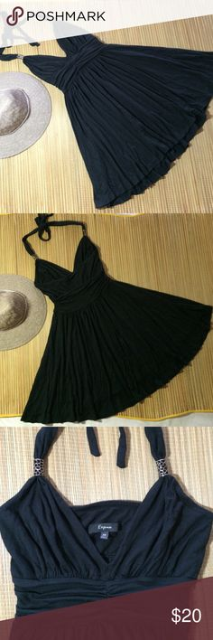 """Chic black dress by Express. XS Sexy black Express halter dress made from 95% Modal 7% spandex. Feels like a t-shirt. Halter straps have metal accents and tie behind neck. Shirred empire waist band and flared skirt. Approx 33"""" length depending on how neck is tied. Express Dresses Mini"""