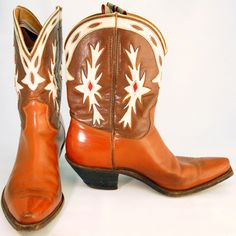 Vintage cowboy boots are men's unmarked two-tone brown with fancy uppers in red and white inlay, brown vamp and buckaroo-style heel. $525 luckystargallery.com