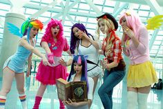 """Female cosplayers as the main characters from """"My Little Pony"""" getting into the act, 'becoming' the characters."""