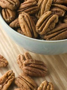 Looking for a sweet treat that won't bust your gut? Try a handful of our Skinny Slow Cooker Sweet and Spicy Pecans. These spicy favorites are the perfect healthy substitute for processed goodies, and they taste amazing, too!  #sweet #spicy #pecans #healthy #snack