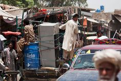 Villagers flee Pakistani tribal areas in North Waziristan following a massive crackdown on militants by the Pakistan army. (AP/B.K. Bangash)...