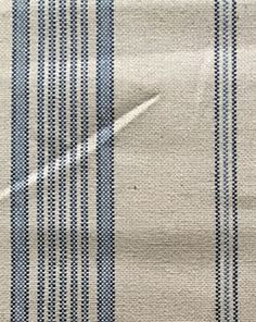 This is a stripe fabric with navy blue and sky blue stripes on a linen blend base cloth in oatmeal. This fabric is great for draperies, valances, throw pillows, bedding, and upholstery. It has a soft feel and a light drape.
