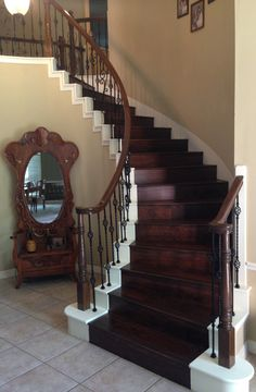 For our latest Houston remodel at the Coppin house we replaced the white posts with stain grade, refinished the handrail so that it would match the treads, and did a full baluster swap. The pattern you see includes our PC6/4, PC6/1, PC22/5, and PC20/1 wrought iron balusters. Striking, is it not?