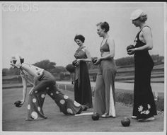 """Women Play Bowls A bowls match with participants wearing the latest fashion in beach pyjamas, England, 1935."""