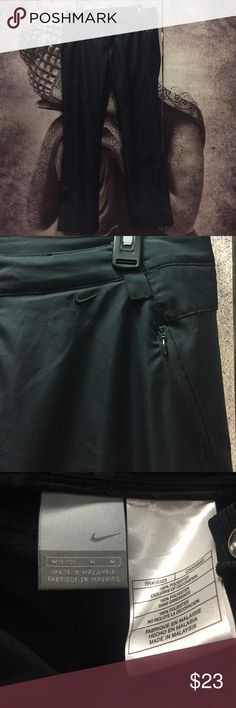 Nike Light Track Pants Nike pants, really light and comfortable pants. Previously worn in excellent condition. Black Nike pants with 3 zippered pockets. Two in the front and one in the back. Also has zipper on sides of bottom of pants as shown on 4th pic to open the bottom of the pants. Nike Pants Track Pants & Joggers