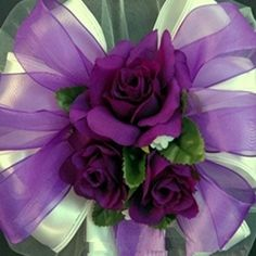 This purple rose wedding pew bow is truly elegant with it's rich colors for the bride who want purple wedding bows.