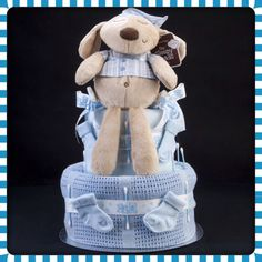 Ingredients • 27 Pampers size 3 Nappies • 1 Cellular Pram/Crib Blanket • 1 Supersoft Fleece Pram/Crib Blanket • Mamas & Papas 'Sleepy Head' Bear • 2 Pairs First size Baby Socks • Finished off with 'bear' ribbon and cotton buds AND • 1 mini bath bomb for Mummy