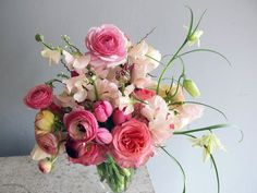 A beautiful bouquet of roses and ranunculus by saipua