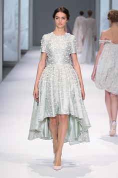 Mint silk zibeline dress and cape with floral thread-work, organza petals and crystal hand embroidery.