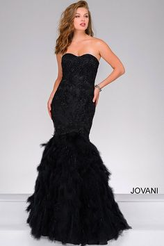 384d5ef55ba Black strapless sweetheart neckline mermaid gown with a feather skirt.