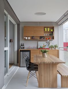 Balcony with wooden furniture ideal to meet with friends and family