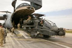 Soldiers from Combat Aviation Brigade, out of Ansbach, Germany offload an Apache helicopter from a Galaxy cargo aircraft in Mazar e Sharif, Afghanistan on 28 April, Attack Helicopter, Military Helicopter, Military Aircraft, Military Jets, Ah 64 Apache, Cargo Aircraft, Longbow, Military Equipment, Special Forces