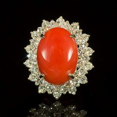 """Retail: $14,675.00 ****** 14K Gold Coral & Diamond Ring ****** Metal: 14K Solid Gold / Total Item Weight: 10.2 grams / Country Made: United States /  / Main Stone: Coral / Color: Orangy Red / Carat Total Weight: 8.69 / Treatment: None / Clarity: Type 2 / Cut: Very Good /  / Secondary Stone: Diamond / Carat Total Weight: 2.98/ Treatment: None / Color Grade : G -H / Clarity: SI1 - SI3/ Cut: Round Brilliant / <br><br><font size=""""-2"""">Ref: YEA-DC-0142</font>"""