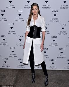 Big night: Gigi Hadid was her own best advert as she celebrated the launch of her Stuart W...