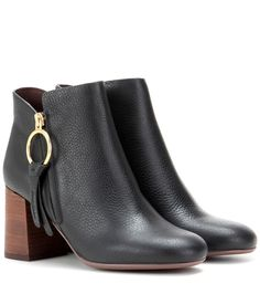 See By Chloé - Leather ankle boots - Be your own boss with See by Chloé's vertiginous black ankle boots. We love the textured, chocolate-hued stacked heel against the grainy black leather finish. A gold-tone zipper tassel adds a playful, bohemian note to this look. Style yours with black skinny jeans for a long-legged finish. seen @ www.mytheresa.com