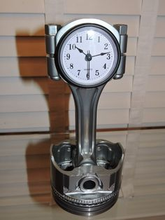These are piston clocks made from recycled Chevy Pistons from 350 (5.7L) engines. they are from different eras and may have a slightly different look form piston to piston. They were cleaned, sandblasted or hand polished (clear only), powder coated, and a clock insert was added. One of these clocks will look great in your office, garage, or man-cave! Please feel free to ask any questions about colors or size. The first photo has orange, green, and clear colors, the second is red, and the…