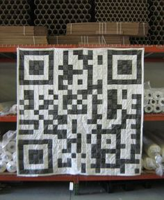 Maker movement combines geeky QR codes with granny quilting into an admittedly charming low tech message on a blanket.
