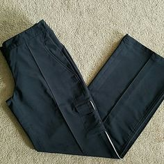 Black Adidas Workout Pants Size Small Black Adidas Workout Pants  Size Small. 31in inseam. Pocket at each hip. Small cargo flap pocket above left knee. Partial elastic waistband. Hidden zipper pocket at right rear. White accent line down side of left leg. In perfect condition! No stains, rips, tears, or holes. Feel free to ask any questions. MAKE ME AN OFFER! FREE GIFT with every purchase! Bundle for further discounts. Adidas Pants