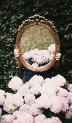 It would be pretty to be sitting on the grass in front of the mirror, so you're in the reflection.