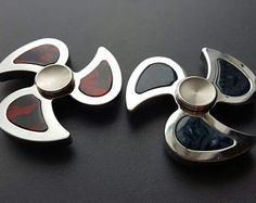 We are excited to introduce to you the new Scorpio, An Ultra Fast EDC Metal Fidget Hand Spinner features a very smooth spin, very durable with a threaded, removable R188 steel metal bearing. The threaded R188 bearing allow for easy cleaning and maintaining. The metal hand fidget spinner comes in two different unique flavor: Pure Stainless Steel and High Temperature treated Rainbow Color. They all come with beautifully machined STAINLESS STEEL CAPS (a $15 value). They all spin very smoothly a... Fidgit Spinner, Pokemon Go, Hand Fidgets, Cool Fidget Toys, Fidget Hand Spinner, Fidget Cube, Metal Detecting, Steel Metal, Cool Gadgets