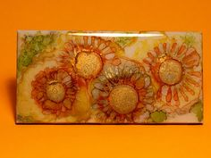 "SunFlowers, An Original 6""x 3"" Ceramic Tile, Hand Painted OOAK (One of a Kind) Alcohol Ink with Waterproof resin and cork or felt backing by YakiArtist  Vibrant colors and nature inspire much of my work. I attempt to create works of art that are beautiful and ethereal. My work is all about the dream……an escape to a magical place. I've allowed myself to surrender to colorful alcohol inks and have developed my own technique that includes the magic of randomly combining the inks along with hand…"