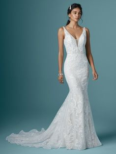 "Try this unique lace mermaid wedding dress for a transformative ""Yes!"" moment. That is, only if you're into gorgeous texture and ultra-chic details in an undeniably flattering silhouette."