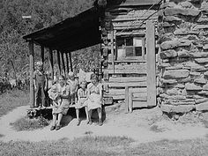 Mountain family on porch of their home made of hand hewn logs up South Fork of Kentucky River, Breathitt County, Kentucky 8c13479u