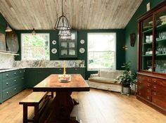 devol kitchens green with marble counters backsplash and a real furniture piece. Kitchen table in the kitchen instead of an island is interesting too. It feels more like a room than the standard kitchen.