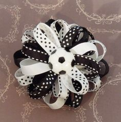 A personal favorite from my Etsy shop https://www.etsy.com/listing/181223014/soccer-hair-bow-black-white-hair-clip