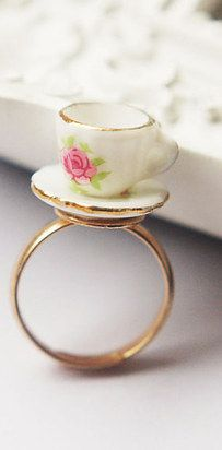 This teeny-tiny porcelain teacup necklace or ring. | 27 Items All Tea Lovers Need In Their Lives