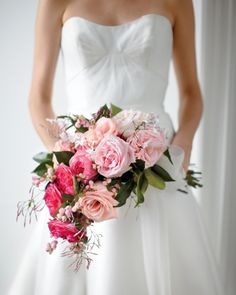 This cascade of jasmine, roses, camellia leaves, and snowberries is meant to spill down the front of your dress