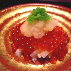 Salmon caviar. Delicious. Like little red translucent pearls.