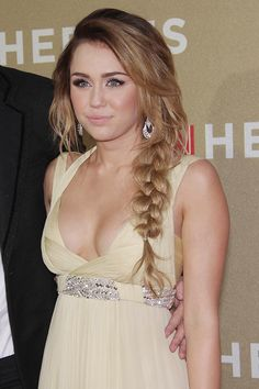 At a 2011 CNN Heroes event, Miley Cyrus wore a fishtail braid styled to the side. Photo: Helga Esteb / Shutterstock.com
