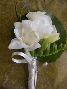 Freesia boutonniere for groomsmen. The freesia flower represents lasting friendship