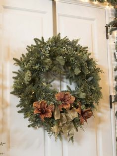 BH Fraser Fir Meadow Wreath embellished with floral sprays and tree ribbon