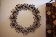 Paper Flower Wreath - made from toilet paper rolls.  So cute.  I'd like to try to make one yellow.