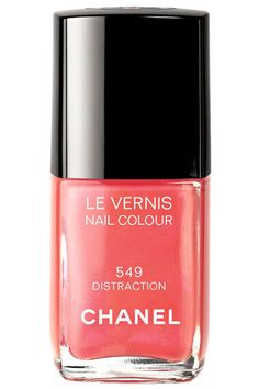 Chanel Le Vernis. Nail colour in Distraction. Chanel's coral is a perfect holiday pick-me-up and fantastic with a tan.