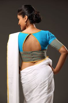 This fun and flirty blouse in a sky blue has buttons and a triangular peep at the back. Yellow edging adds to the cheekiness. Kummi is a folk dance of Kerala...