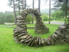 Helical stone walls and arches that Thea Sunshine Alvin has built in her front garden.