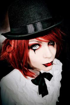 Lua Morales in her top hat and sad clown make-up | See more about Goth Girls…