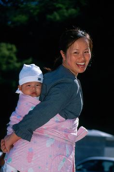 mother carrying baby on back in traditional Korean manner; Pusan, South Korea; photography by Blaine Harrington