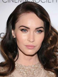 Megan Fox not so smoky eyes  Not so bold yet sultry version of smokey eyes. Apply a medium or dark brown on your inner rims and smudging it on the top outer corners of the lid. Blend in a champagne color applied over the entire lid. With the same color brighten under the bottom lashes and apply a dot at the inner corners to light up eyes. If you want apply individual false lashes at the outer corners for that striking look or lengthen and add volume to your natural ones.