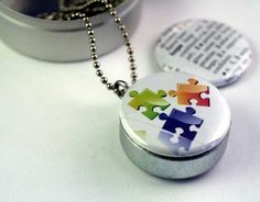 Autism puzzle piece locket - Etsy