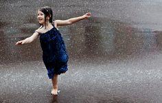 kid dancing in the rain