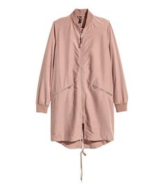 Dusty pink. Long jacket in a woven modal blend with a matte silk finish. Two-way zip at front, diagonal front pockets with zip, drawstring at hem, and