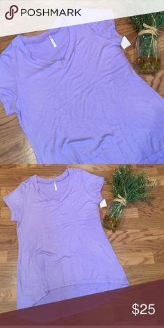 High Low soft Tee🌷 Lovely deep lavender top that just didn't fit me right.🌸  I have thick upper arms and the sleeves are just to tight.  But overall I love it!  It's NWT that is shown in the picture.  Purchased from a fellow posher❤️ Tops